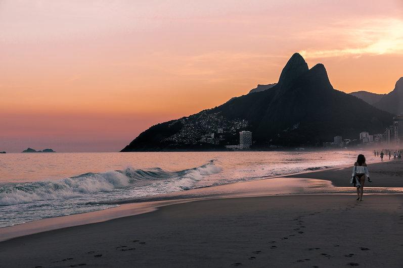 latina-woman-walking-ipanema-beach-sunse
