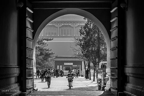 Street photograph of a tunnel arch doorway at the Forbidden City in Beijing, China