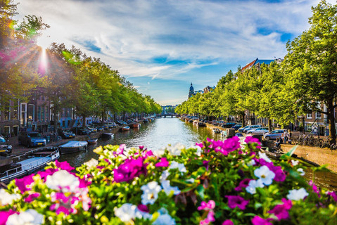 flowers-on-bridge-sunset-canal-view-back