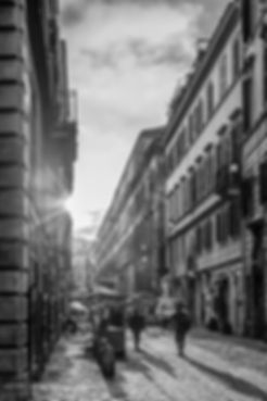 Black and white street photograph of a street scene in the morning in Rome, Italy
