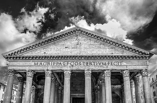 Black and white street photograph of the ancient Pantheon facade in Rome, Italy