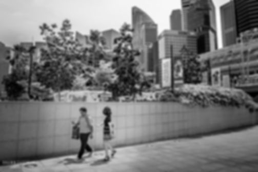 Street photograph of a black and white street scene in Singapore