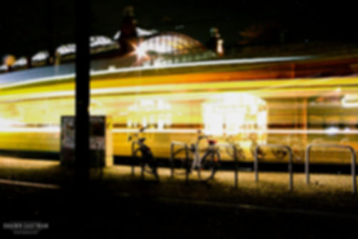 Street photograph of a tram speeding past in Berlin, Germany