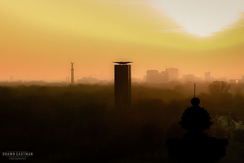 Street photograph of sunset from the top of the Reichstag building, overlooking Berlin, Germany