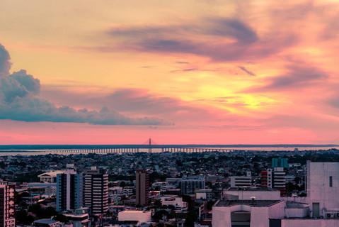 sunset-over-ponta-negra-river-bridge-man