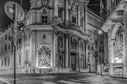 Black and white street photograph night shot of a night scene in Rome, Italy