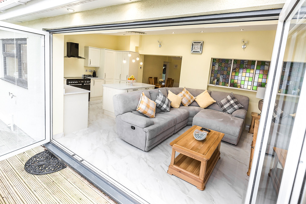 Kitchen and lounge extension opening up into the garden in a property in Cardiff, South Wales