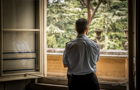 guard-looking-out-window-vatican-museum-