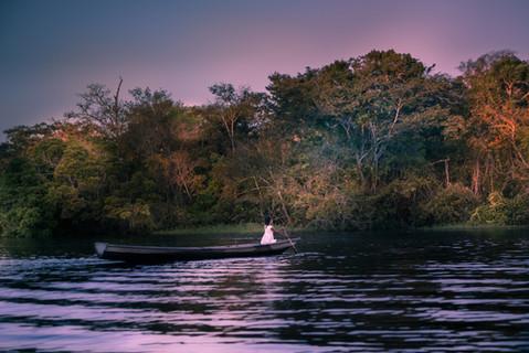 young-girl-rowing-boat-amazon-river-dusk