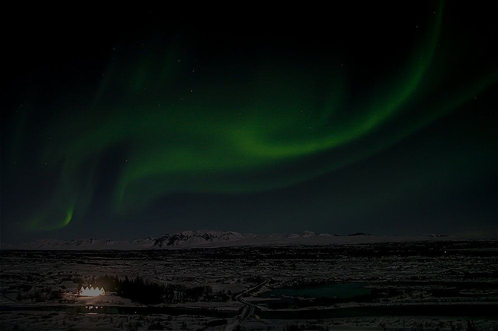 The Northern Lights (Aurora Borealis) over Thingvellir National Park in Iceland