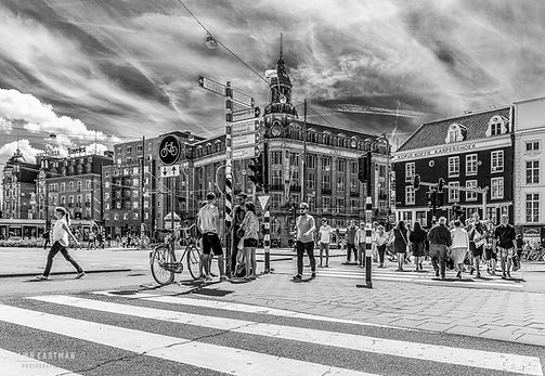 Black and white street photograph of a shot in Amsterdam, the Netherlands