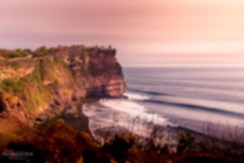 Landscape photograph of a sunset at Uluwatu temple in Bali, Indonesia