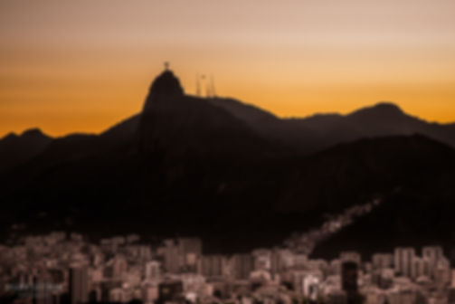 Landscape photograph of the sunset view of Christ the Redeemer in Rio De Janeiro, Brazil