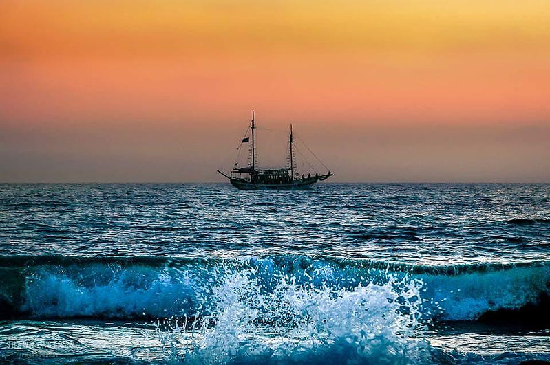 ship-choppy-waters-sunset-mediterranean-