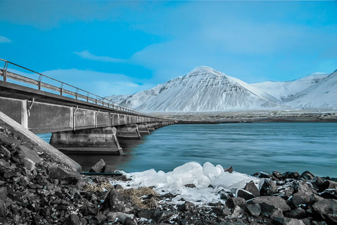 bridge-river-snow-capped-mountain-icelan