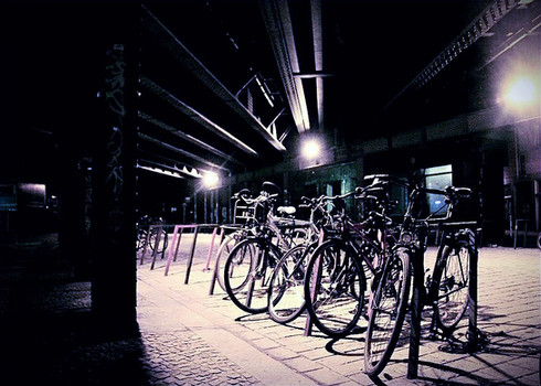 bicycles-chained-up-night-street-scene-b