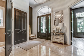 """Soaring 8' interior doors on main floor, fixed with Emtek levers will capture the grandeur of the mainfloor. Did I mention the 7"""" baseboards?..."""