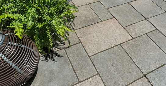 Curb appeal that actually starts at the curb. Unilock's Windermere pavers with its gentle surface clefts and clean edges give your driveway and walkway an elegant and relaxed look.