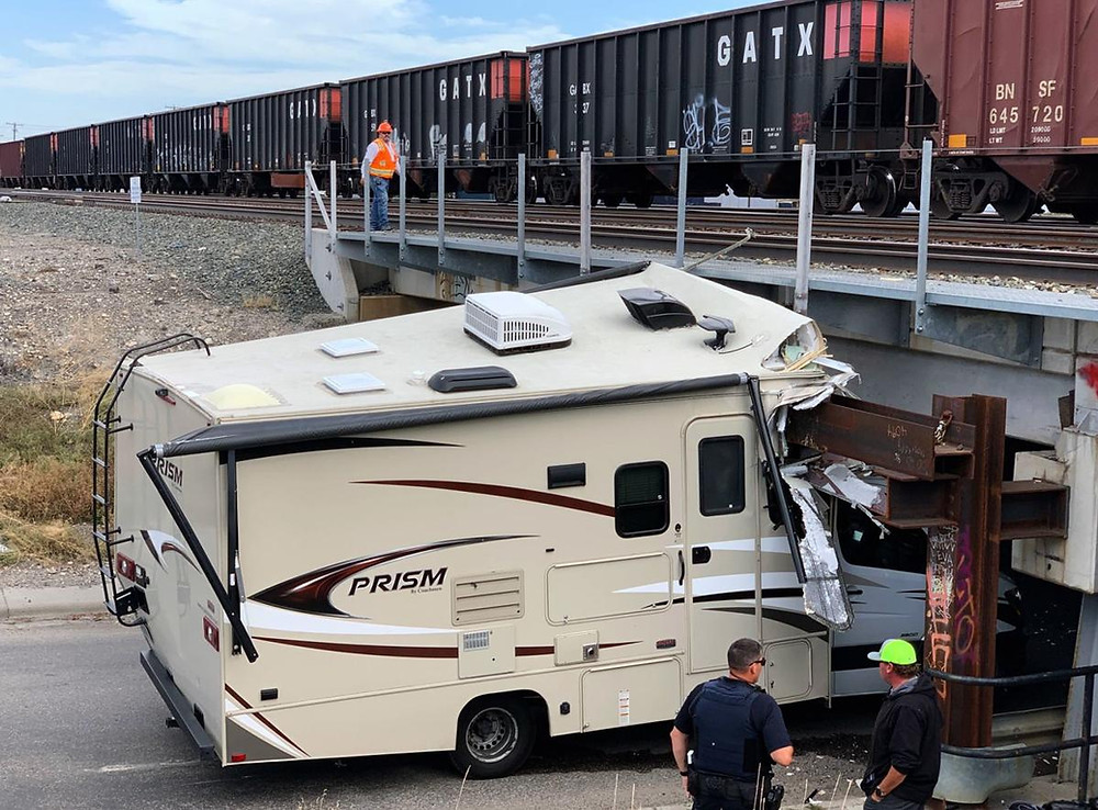 An RV experiences a common RV mishaps and crashes into a bridge.