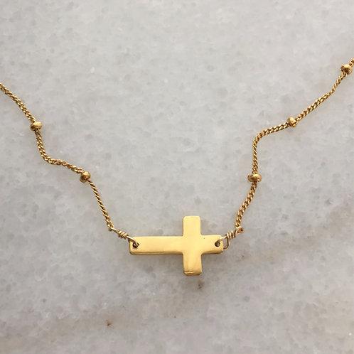křížek.