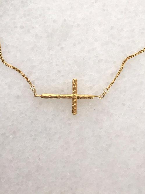 tepaný křížek.