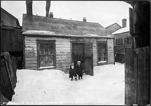 Old Houses (rear view including two children)- Centre Avenue, Arthur Goss, February 23 rd 1912, Fonds 200, Series 372, Subseries 32, Item 40, Department of Public Works Photographs, City of Toronto Archives