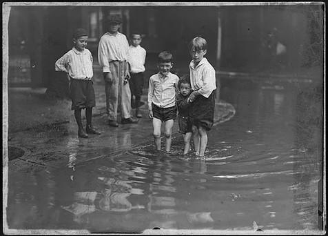 Children in a Flooded Slum Street, William James, ca. 1914, Fonds 1244, Item 8026, William James Family Fonds, City of Toronto Archives