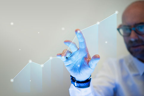 businessman-pointing-his-finger-growth-graph.jpg