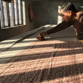 Ramnarayan printing Snail II in evening sunlight.