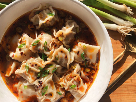 Chinese Dumplings with a Spicy Red Chili Broth