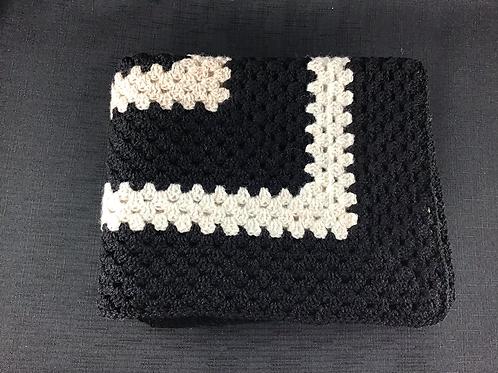 Black and white crocheted blanket