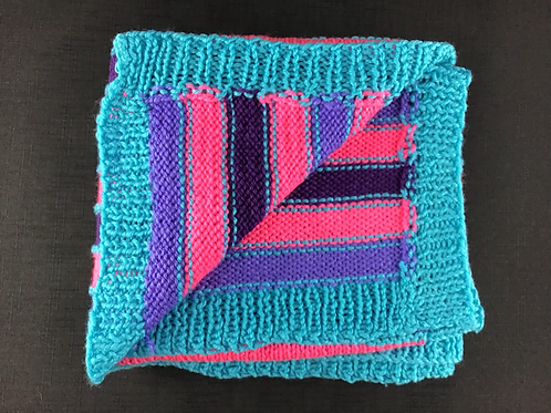 Blue purple and pink knitted blanket