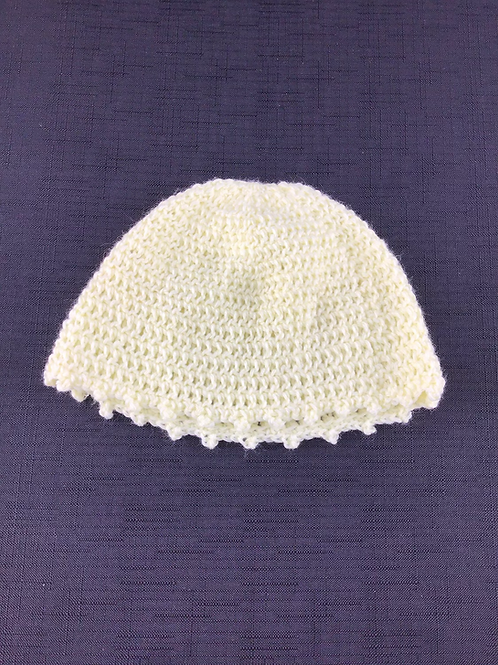 Yellow knitted bonnet