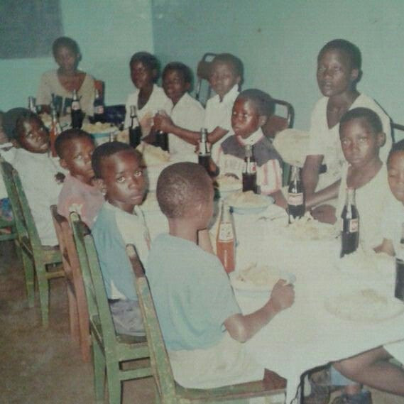 Christmas one yr at children's home - it was a good place despite the lack of smiles. That's me second from front on left side -  looking straight at camera