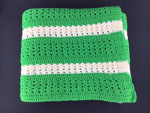 Green and white crocheted blanket