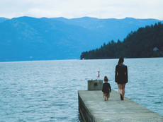 Woman and child on a dock