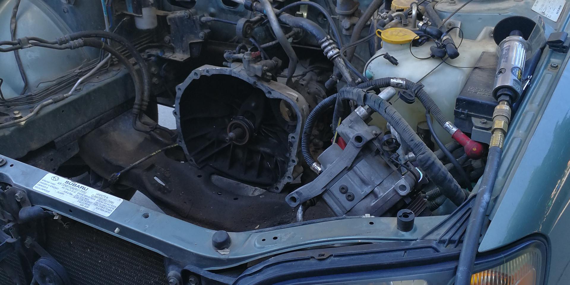 Empty Subaru engine bay.
