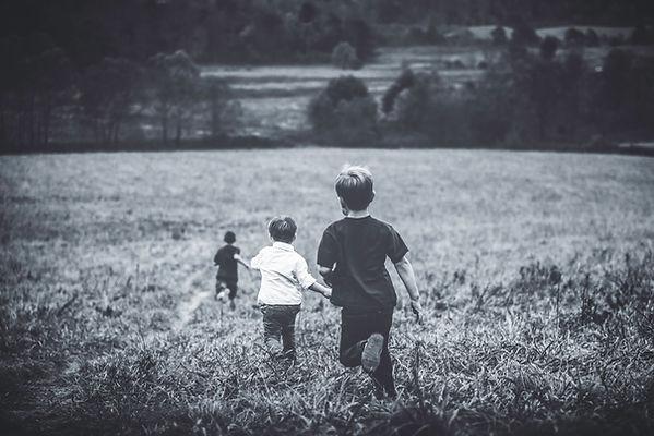Boys running in field