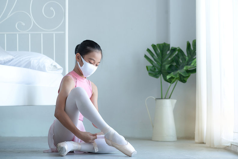 Asian young ballerina with face mask wea