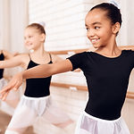 Young ballerinas rehearsing in the ballet class. They perform different choreographic exer