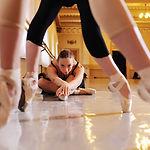 three young cute ballerinas perform exer