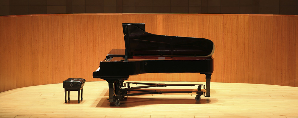 Acoustic piano on stage