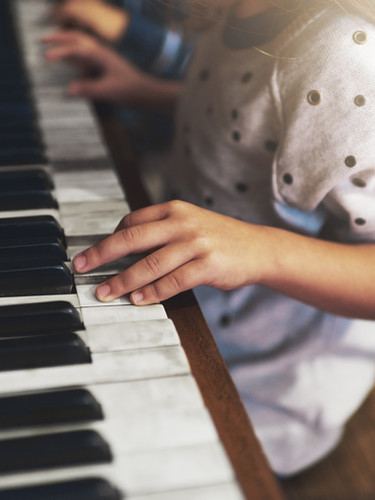Children learn piano at an early age!