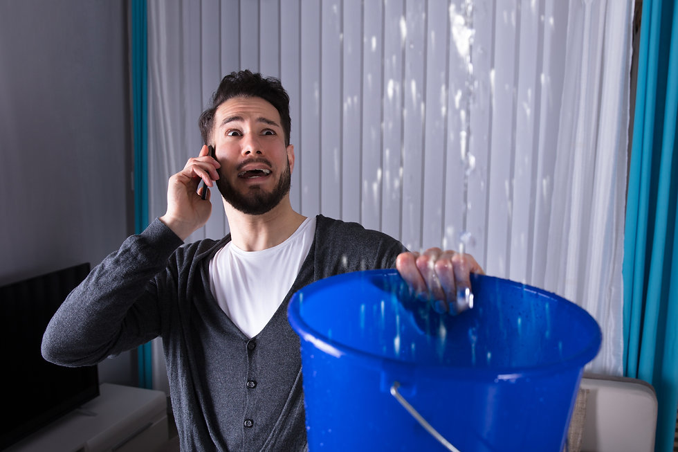 Worried Young Man Calling Plumber While