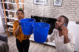 Couple Using Bucket For Collecting Water