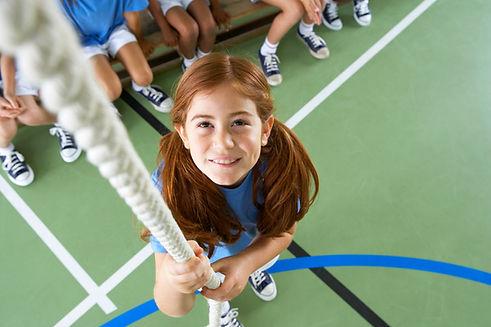 Girl climbing rope