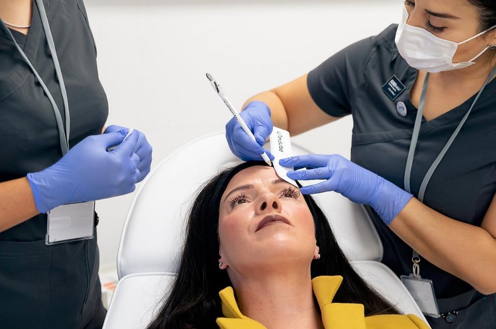 Rehanna providing botox treatment to a patient at iFab Clinic