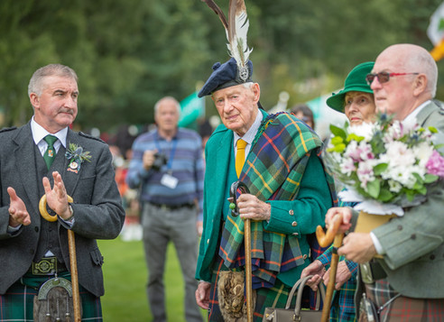The Ballater Highland Games officials and spectators applaud the Chief in honour of his 100th Birthday in 2019