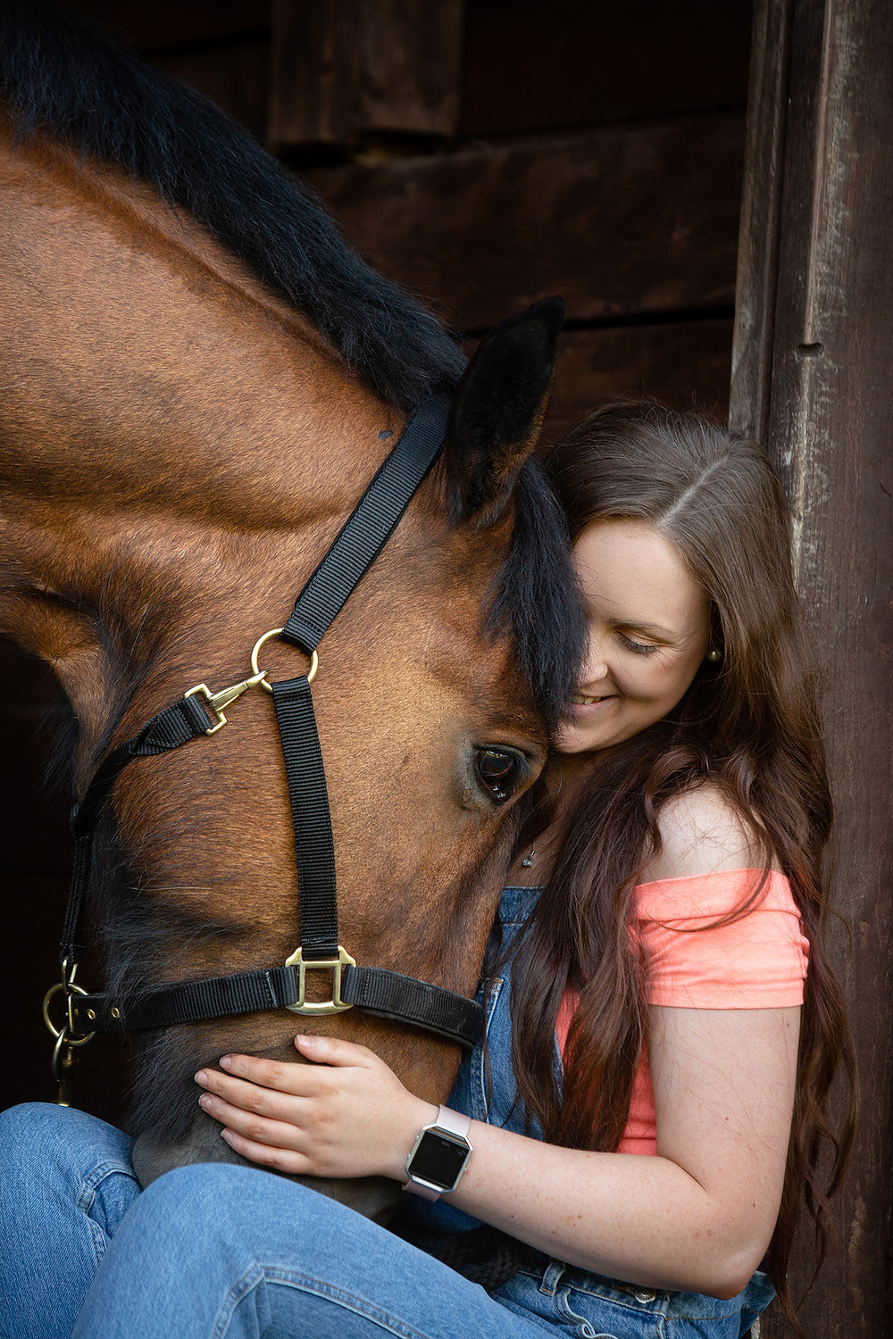 Author Lois Kingscott smiles and cuddles her horse Dave