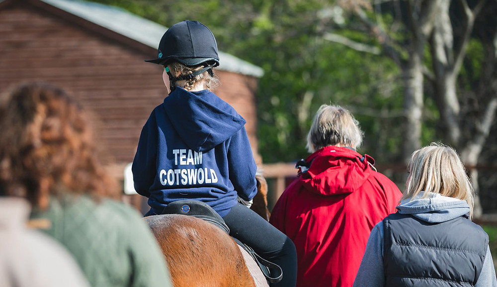 A rider and volunteers at Cotswold Riding for the Disabled